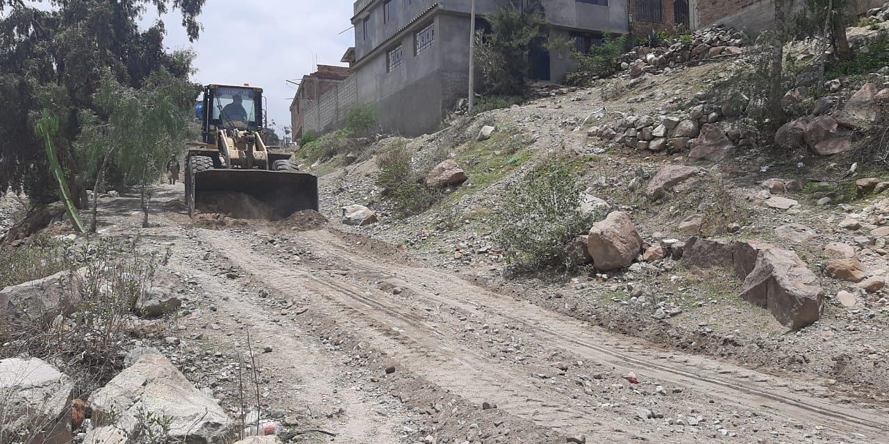 Aplanamiento de carretera en Asociación de Vivienda  Villa Candelaria